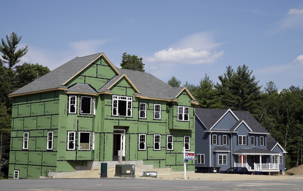 FILE - This Monday, July 10, 2017, file photo shows new housing construction, in North Andover, Mass. On Thursday, Dec. 28, 2017, Freddie Mac reports ...