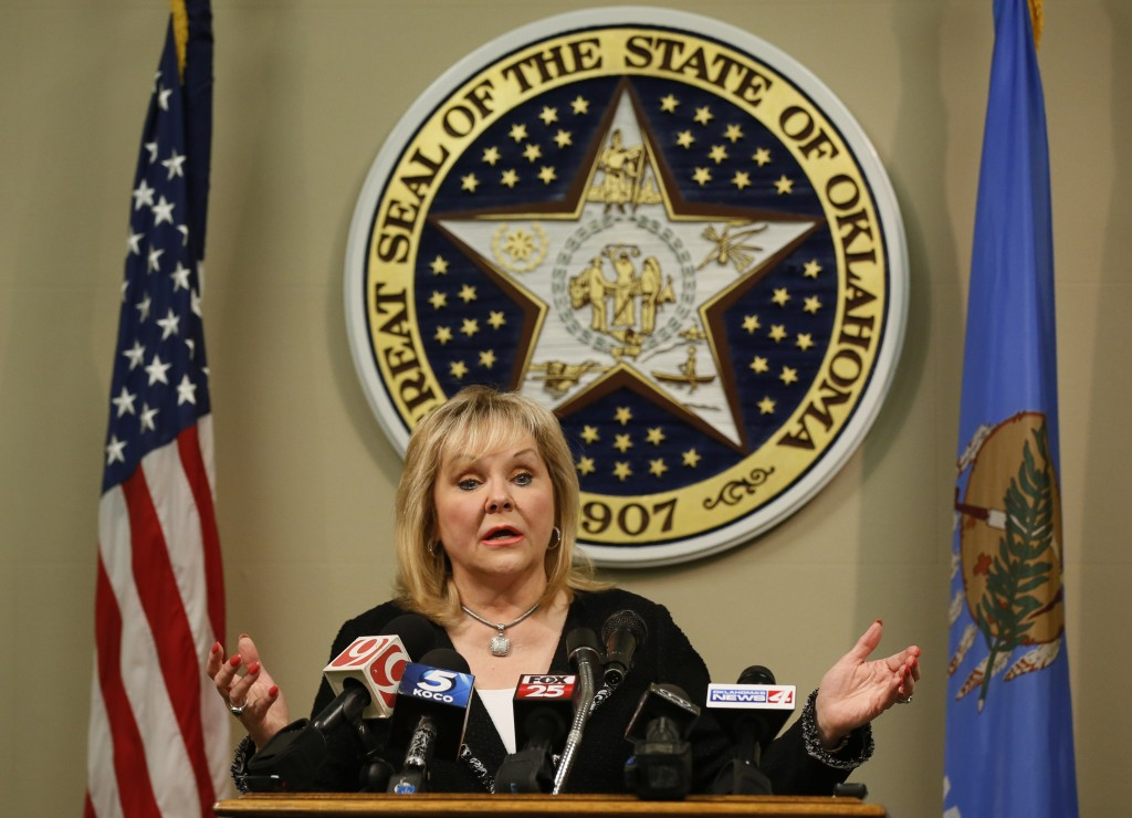 FILE - In this Nov. 21, 2017, file photo, Oklahoma Gov. Mary Fallin speaks during a news conference in Oklahoma City. With one of the busiest death ch...