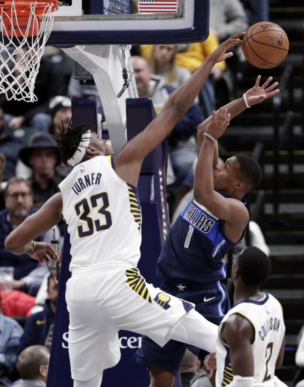 Indiana Pacers center Myles Turner (33) blocks the shot of Dallas Mavericks guard Dennis Smith Jr. (1) during the second half of an NBA basketball gam...