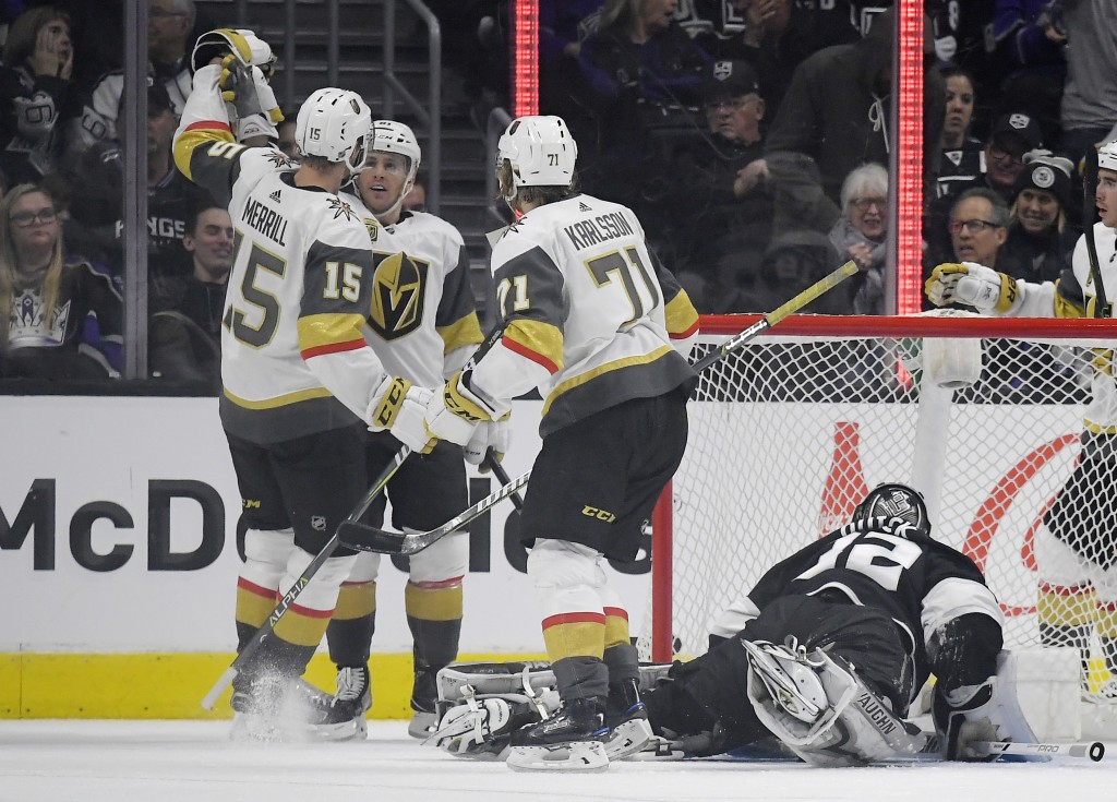 Vegas Golden Knights center Jonathan Marchessault, second from left, celebrates his goal with defenseman Jon Merrill, left, and center William Karlsso...
