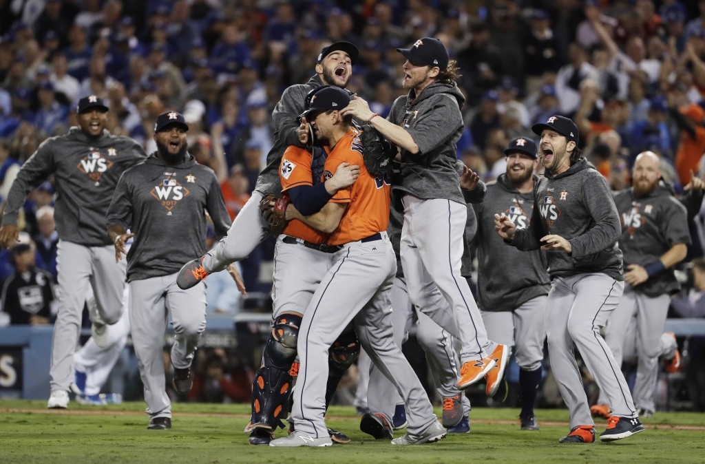 FILE- in this Nov. 1, 2017, file photo, the Houston Astros celebrate after Game 7 of baseball's World Series against the Los Angeles Dodgers, in Los A...