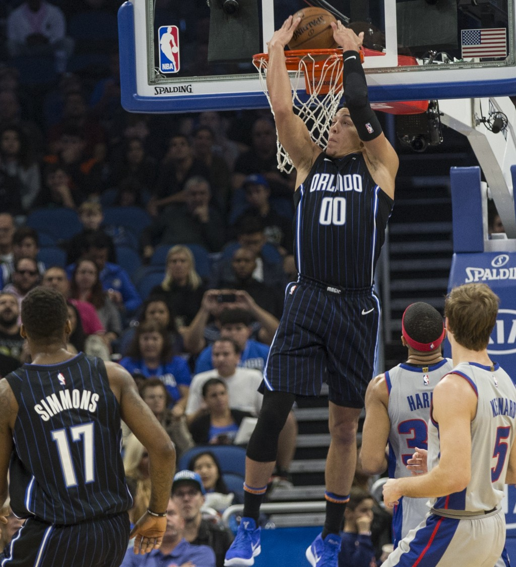 Orlando Magic forward Aaron Gordon (00) reverse-dunks after a pass during the first half of the team's NBA basketball game against Detroit Pistons in ...