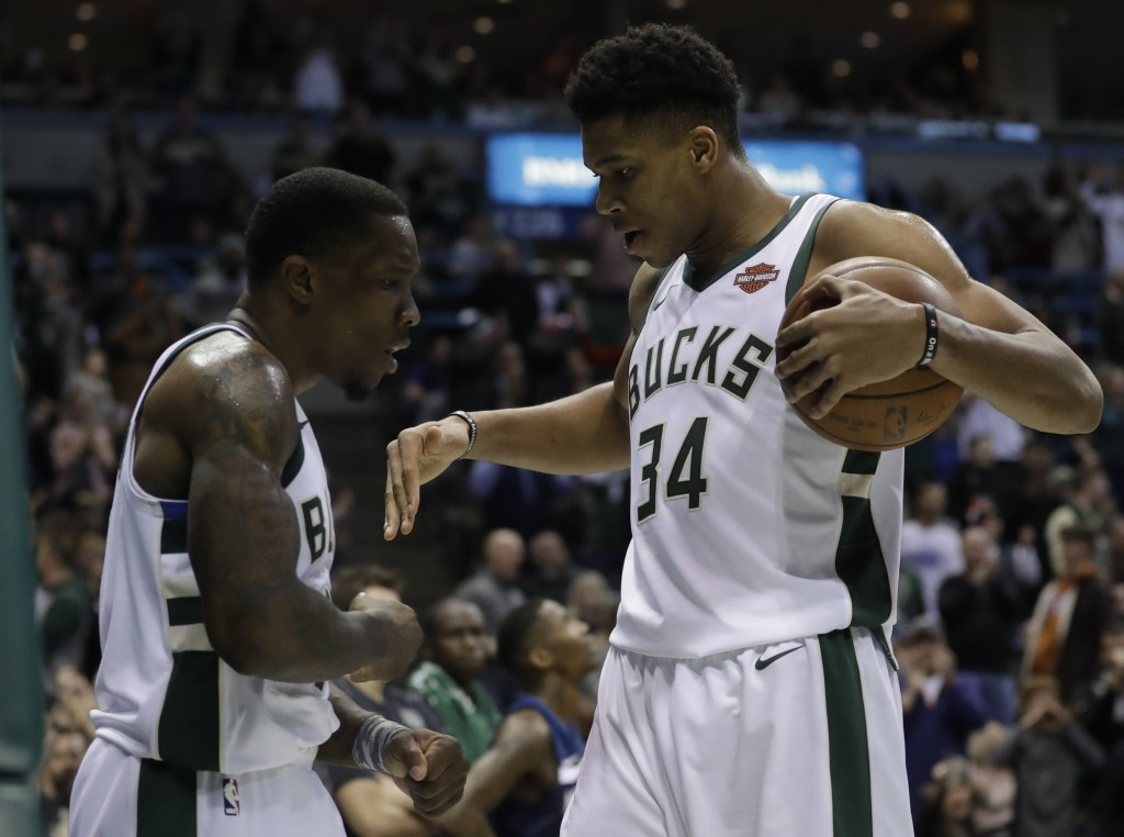 Milwaukee Bucks' Eric Bledsoe and Giannis Antetokounmpo celebrate during the second half of an NBA basketball game against the Minnesota Timberwolves ...