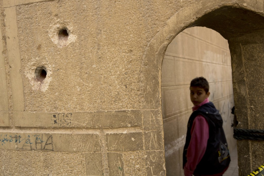 Bullets holes are seen on the police booth outside Mar Mina church, in Helwan, Cairo, Egypt, Friday, Dec. 29, 2017, where at least 10 people, includin...