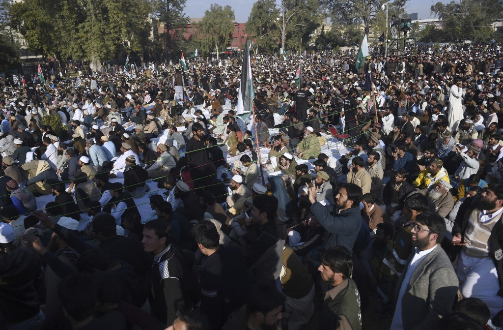 Supporters of the Pakistan Defense Council, an alliance of hardline Islamist religious parties participate in a rally against America, in Rawalpindi, ...
