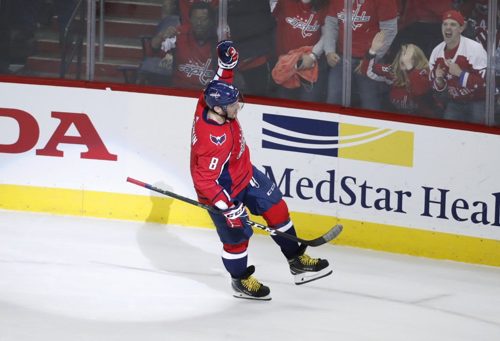 Washington Capitals left wing Alex Ovechkin (8), from Russia, celebrates the only goal of the shootout in an NHL hockey game against the Boston Bruins...