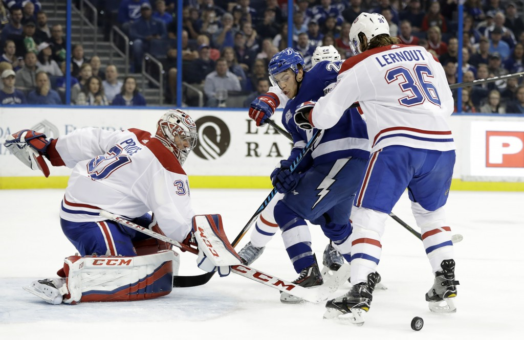 Montreal Canadiens goalie Carey Price (31) makes a save on a shot by Tampa Bay Lightning center Brayden Point (21) during the second period of an NHL ...