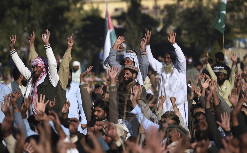 Supporters of the Pakistan Defense Council, an alliance of hardline Islamist religious parties, chant slogans during a rally against America, in Rawal...