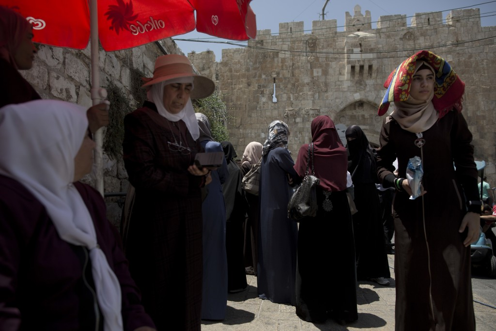 In this Wednesday, July 19, 2017 photo, Palestinians gather for prayer outside the Lion's Gate following an appeal from clerics to pray in the streets...