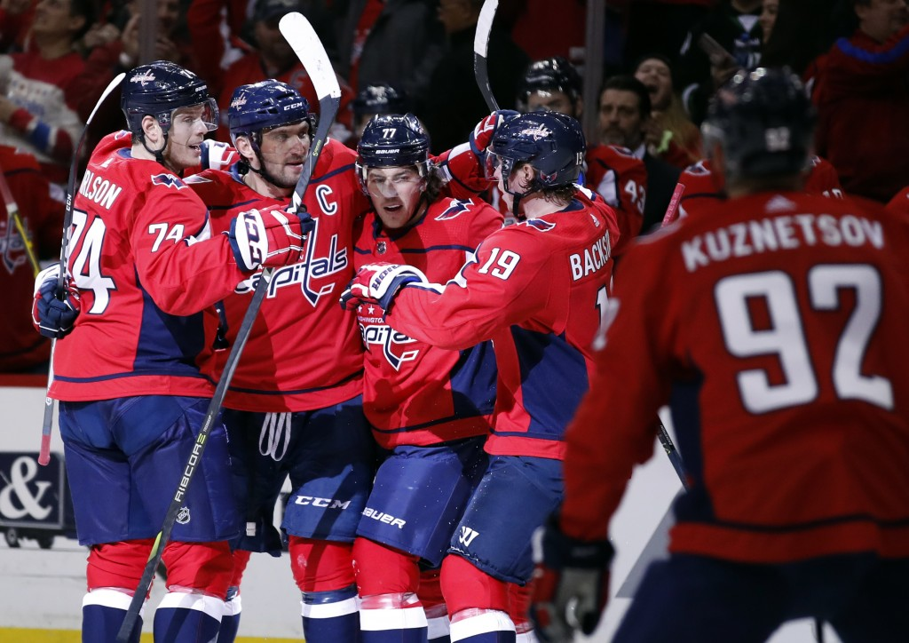 Washington Capitals defenseman John Carlson, left; left wing Alex Ovechkin, from Russia; right wing T.J. Oshie; and center Nicklas Backstrom, from Swe...