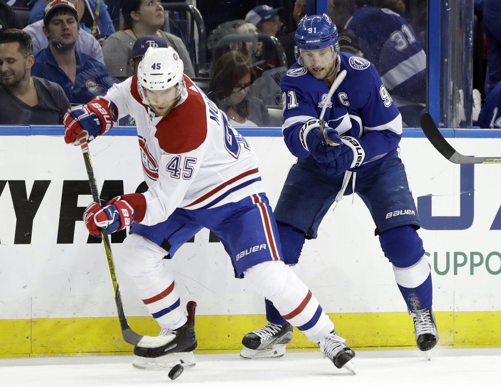 Montreal Canadiens defenseman Joe Morrow (45) strips the puck from Tampa Bay Lightning center Steven Stamkos (91) during the second period of an NHL h...
