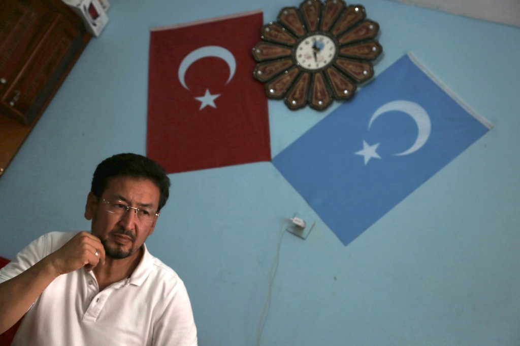 In this Aug. 7, 2017 photo, Seyit Tumturk, a Uighur activist speaks near in a resettlement community in Kayseri in central Turkey. As Uighurs flee a C...