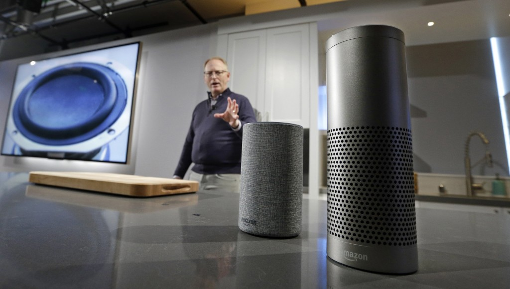 FILE - In this Wednesday, Sept. 27, 2017, file photo, David Limp, senior vice president of Devices and Services at Amazon, displays a new Echo, left, ...