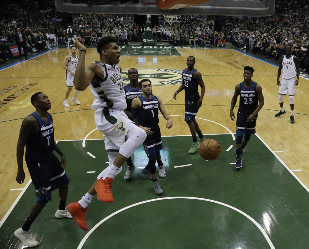 Milwaukee Bucks' Giannis Antetokounmpo dunks during the second half of an NBA basketball game against the Minnesota Timberwolves Thursday, Dec. 28, 20...