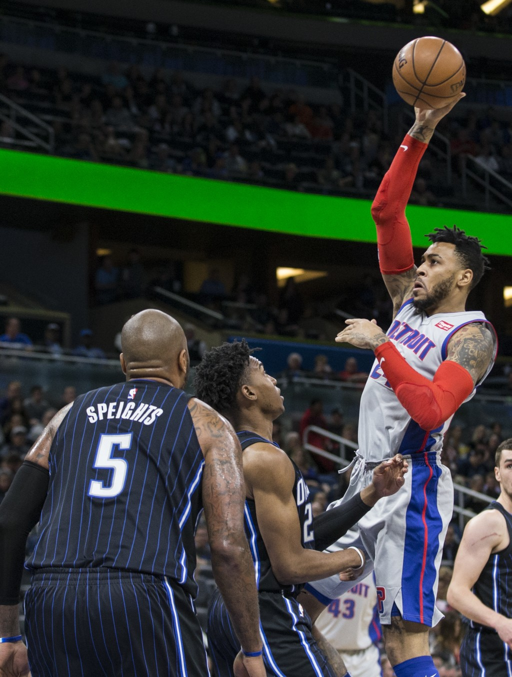 Detroit Pistons forward Eric Moreland (24) drives by Orlando Magic forward Wesley Iwundu, center, and forward Marreese Speights (5) during the first h...