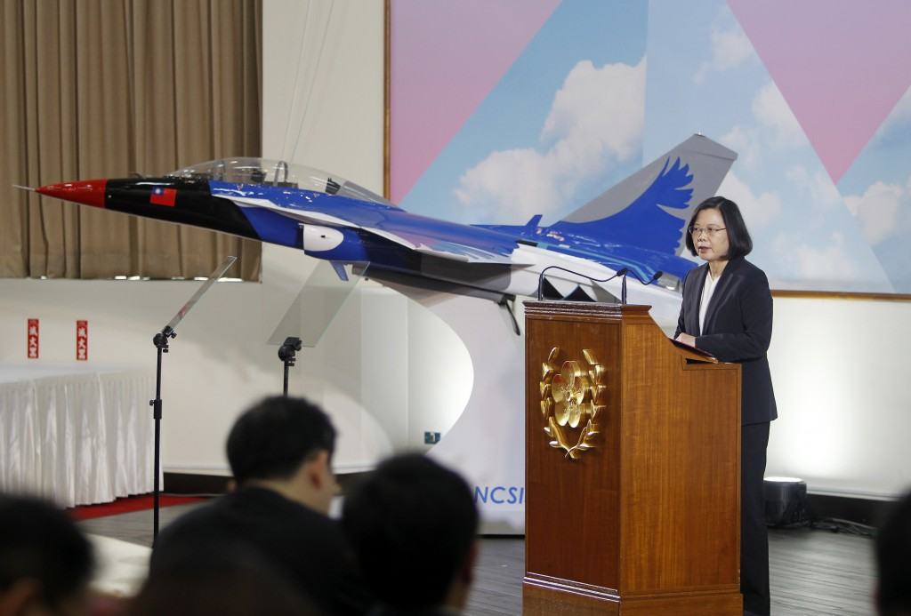 Taiwan's President Tsai Ing-wen delivers a speech in front of a model of Taiwan made Advanced Jet Trainer during the year-end media event at the Natio...