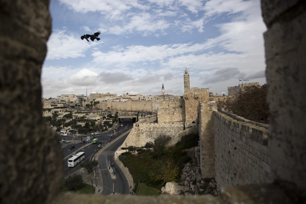 In this Sunday, Dec. 24, 2017 photo, a view of Jerusalem Old City seen from the Jerusalem Ramparts Walk. Jerusalem's iconic Old City walls have been a...