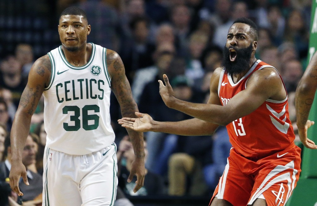 Houston Rockets' James Harden (13) protests a call beside Boston Celtics' Marcus Smart (36) during the first quarter of an NBA basketball game in Bost...