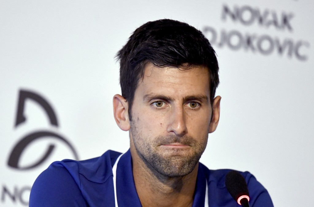 FILE - In this Wednesday, July 26, 2017 file photo, tennis player Novak Djokovic pauses during a press conference in Belgrade, Serbia. Novak has withd...