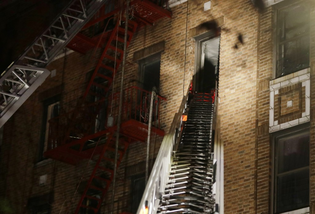 Firefighters respond to a deadly fire Thursday, Dec. 28, 2017, in the Bronx borough of New York. The New York City mayor's press secretary says severa...