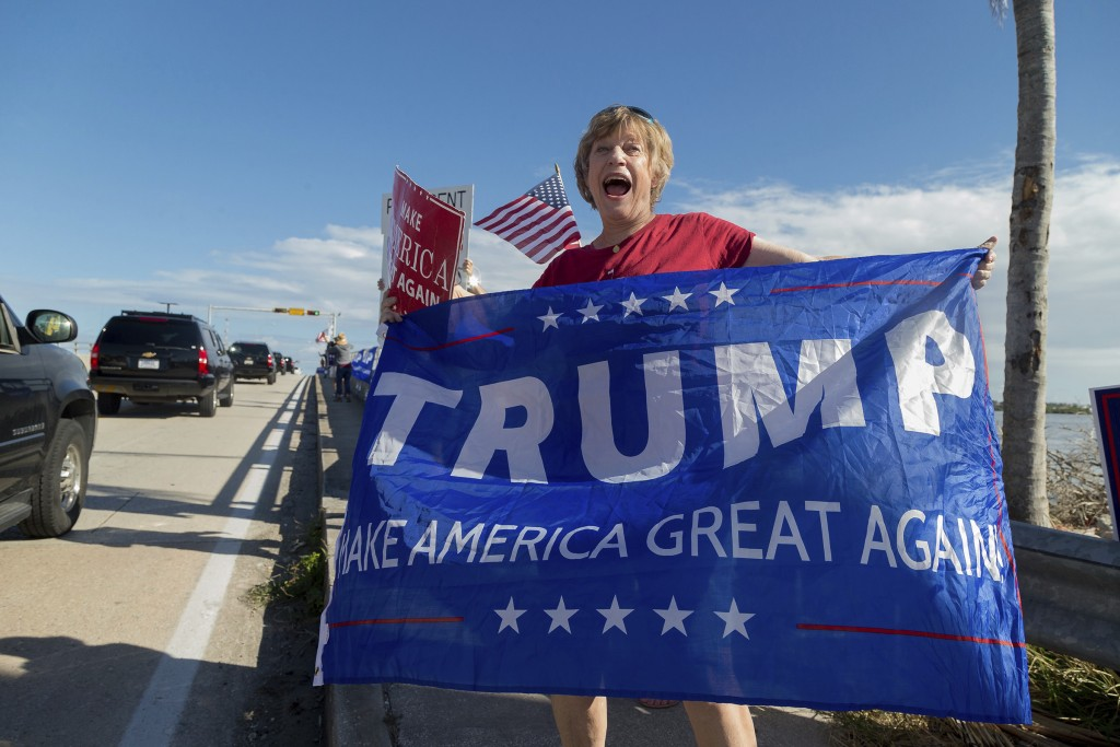 Mary Jude Smith cheers for President Donald Trump as his motorcade passes by on Southern Blvd. enroute to his Mar-a-Lago estate from Trump Internation...