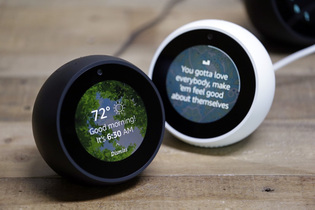 FILE - In this Wednesday, Sept. 27, 2017, file photo, Amazon Echo Spots are displayed during a program announcing several new Amazon products by the c...