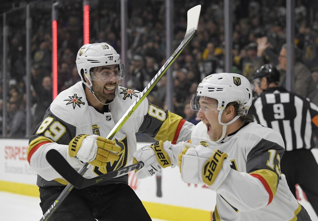 Vegas Golden Knights left wing Brendan Leipsic, right, celebrates his goal with right wing Alex Tuch during the third period of an NHL hockey game aga...