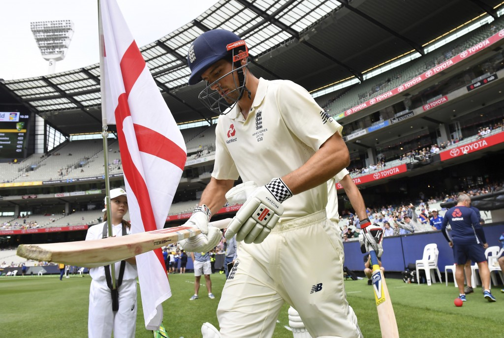 England's Alastair Cook runs out against Australia at the start of the fourth day of their Ashes cricket test match in Melbourne, Australia, Friday, D...