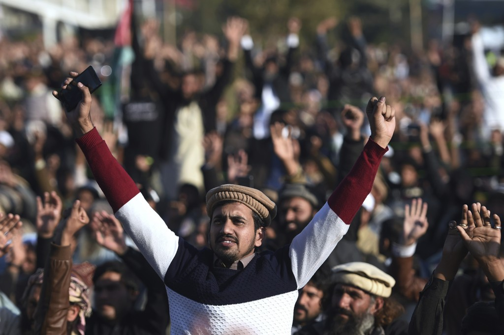 Supporters of the Pakistan Defense Council, an alliance of hardline Islamist religious parties, participate in a rally against America, in Rawalpindi,...