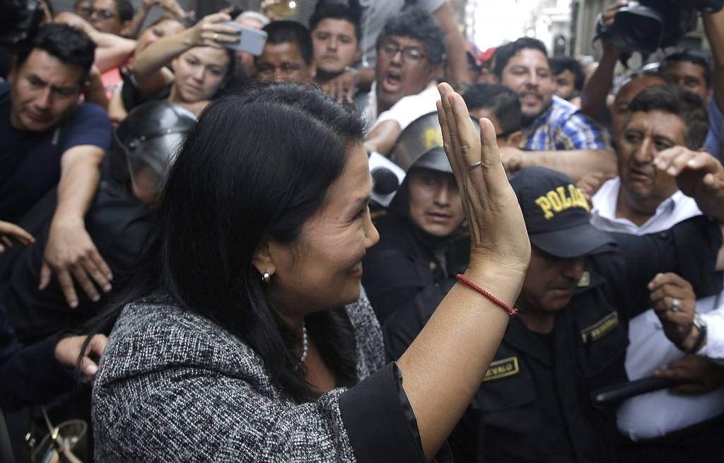 In this Dec. 28, 2017 photo, Keiko Fujimori, daughter of former President Alberto Fujimori, smiles and waves to the press after she testified before p...