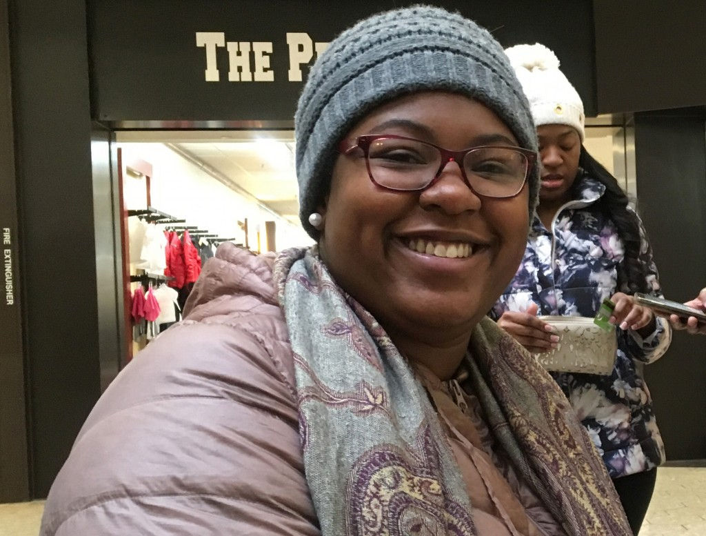 In this Dec. 9, 2017, photo, Sharonda Dozier, of Detroit, poses for a photo at Fairlane Town Center in the Detroit suburb of Dearborn, Mich. Dozier's ...
