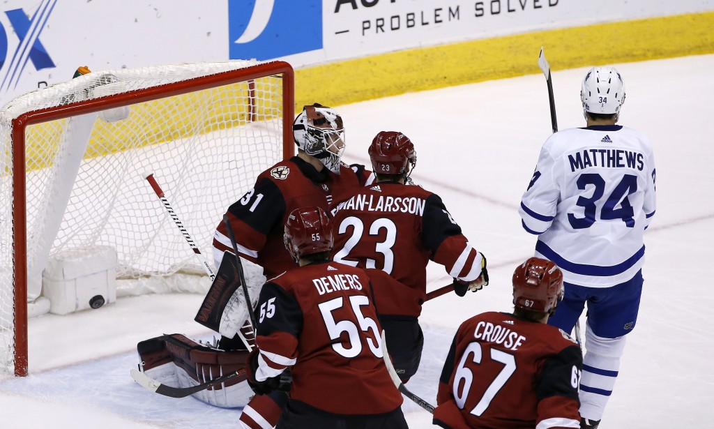 Toronto Maple Leafs center Auston Matthews (34) beats Arizona Coyotes goalie Scott Wedgewood (31) for a goal as Coyotes defenseman Oliver Ekman-Larsso...