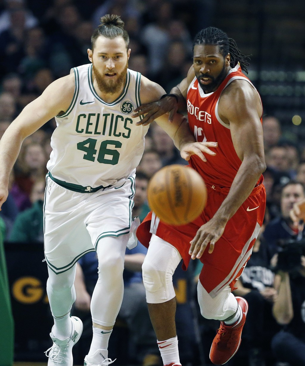 Boston Celtics' Aron Baynes (46) and Houston Rockets' Nene chase the ball during the first quarter of an NBA basketball game in Boston, Thursday, Dec....