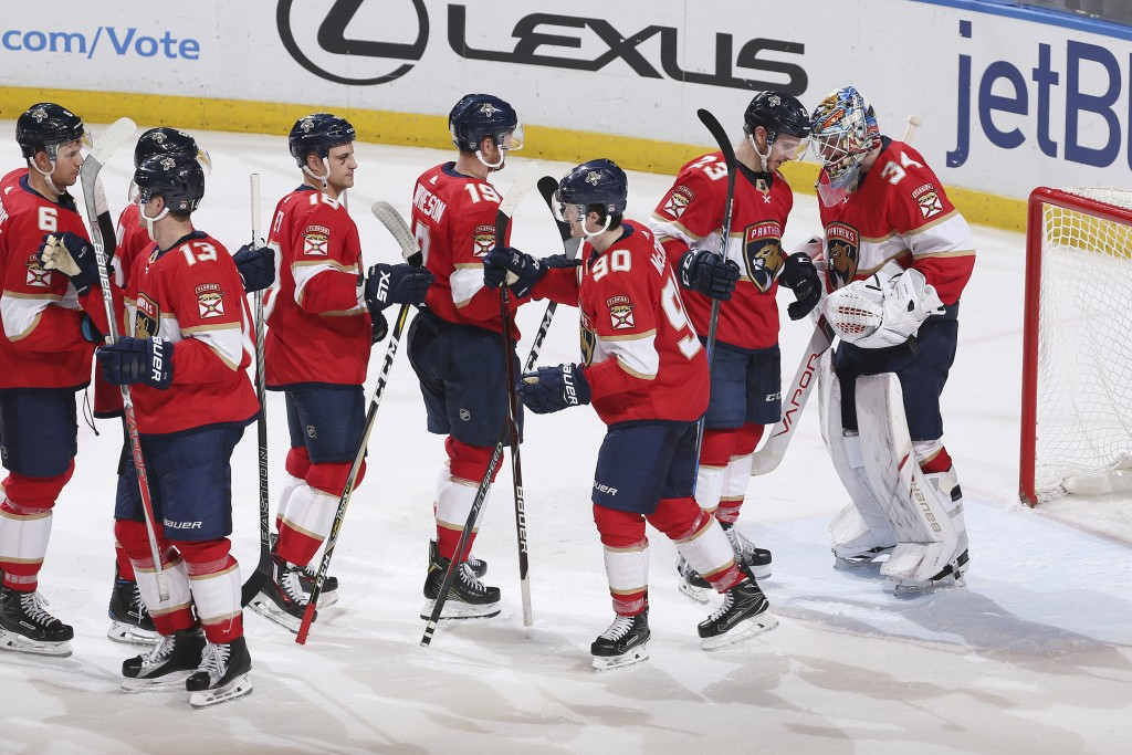 Florida Panthers goaltender James Reimer (34) celebrates a victory over the Philadelphia Flyers with teammates after the third period of an NHL hockey...
