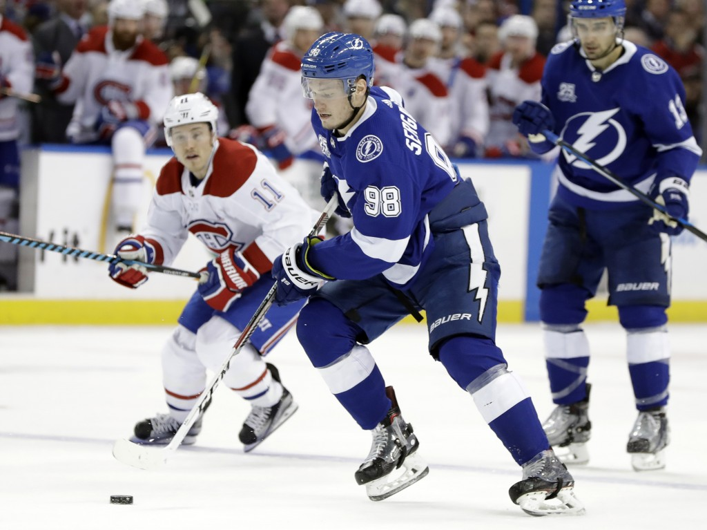 Tampa Bay Lightning defenseman Mikhail Sergachev (98), of Russia, cuts in front of Montreal Canadiens right wing Brendan Gallagher (11) during the sec...