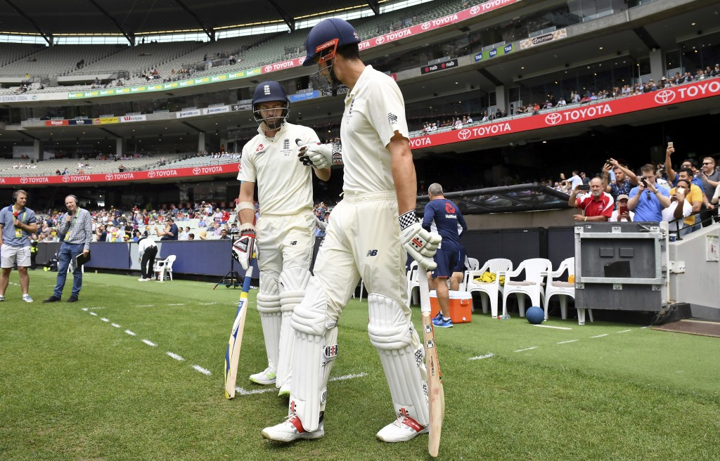 England's Alastair Cook, right, and James Anderson prepare to run out against Australia at the start of the fourth day of their Ashes cricket test mat...