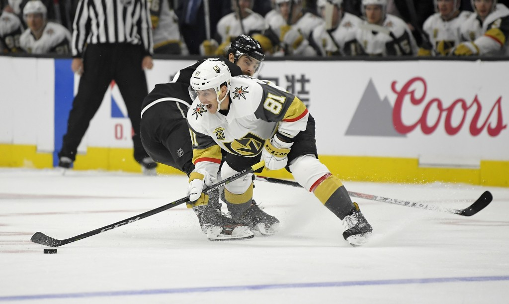 Vegas Golden Knights center Jonathan Marchessault, right, moves the puck past Los Angeles Kings defenseman Drew Doughty during the second period of an...