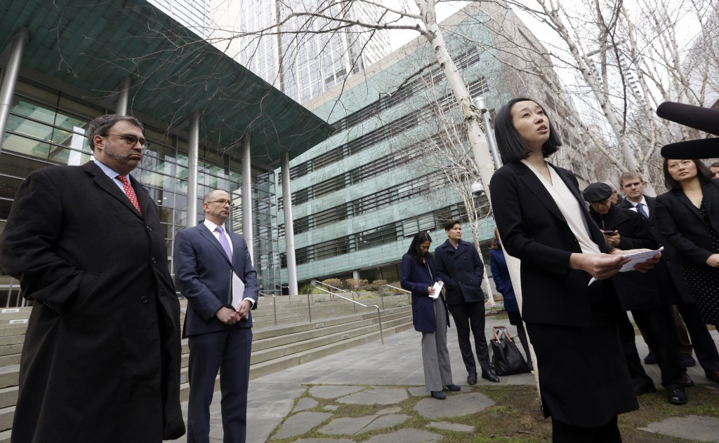 FILE- In this Dec. 21, 2017, file photo, Mariko Hirose, right, a litigation director at the Urban Justice Center, addresses reporters as Mark Hetfield...