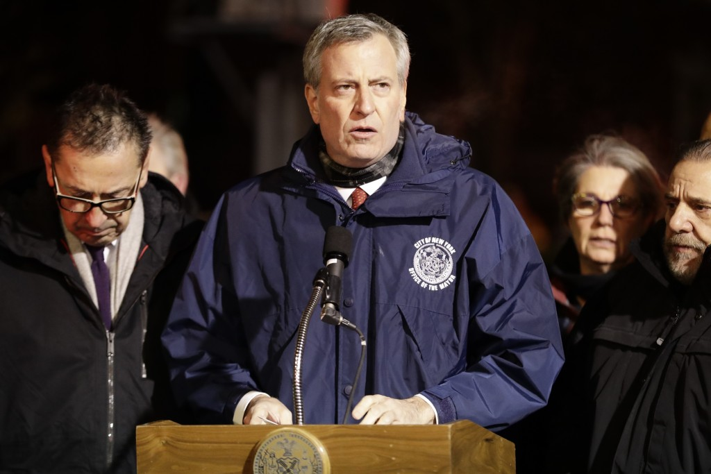 New York City Mayor Bill de Blasio speaks during a news conference after fire crews responded to a building fire Thursday, Dec. 28, 2017, in the Bronx...