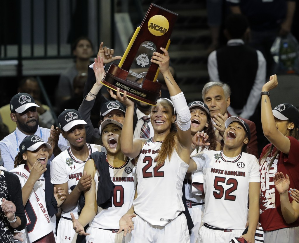 File- This April 2, 2017, file photo shows South Carolina forward A'ja Wilson (22) holding up the trophy as she celebrates with teammates after their ...