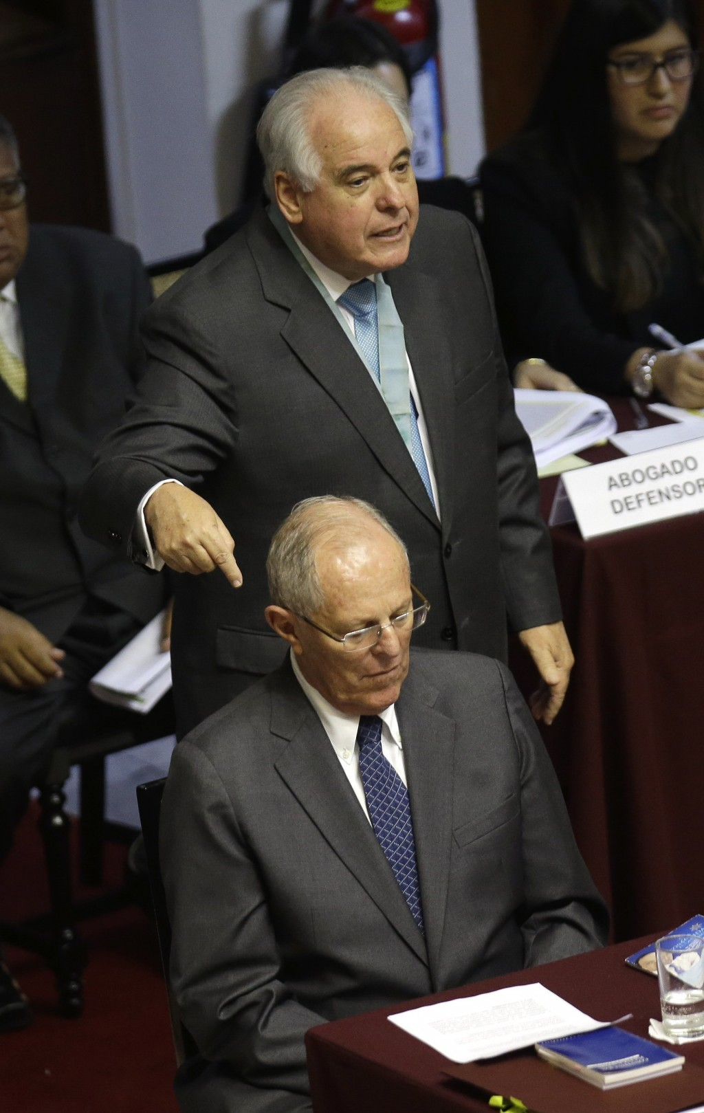 In this Dec. 21, 2017 photo, lawyer Alberto Borea points to President Pedro Pablo Kuczynski as he defends the Peruvian leader before Congress in Lima,...
