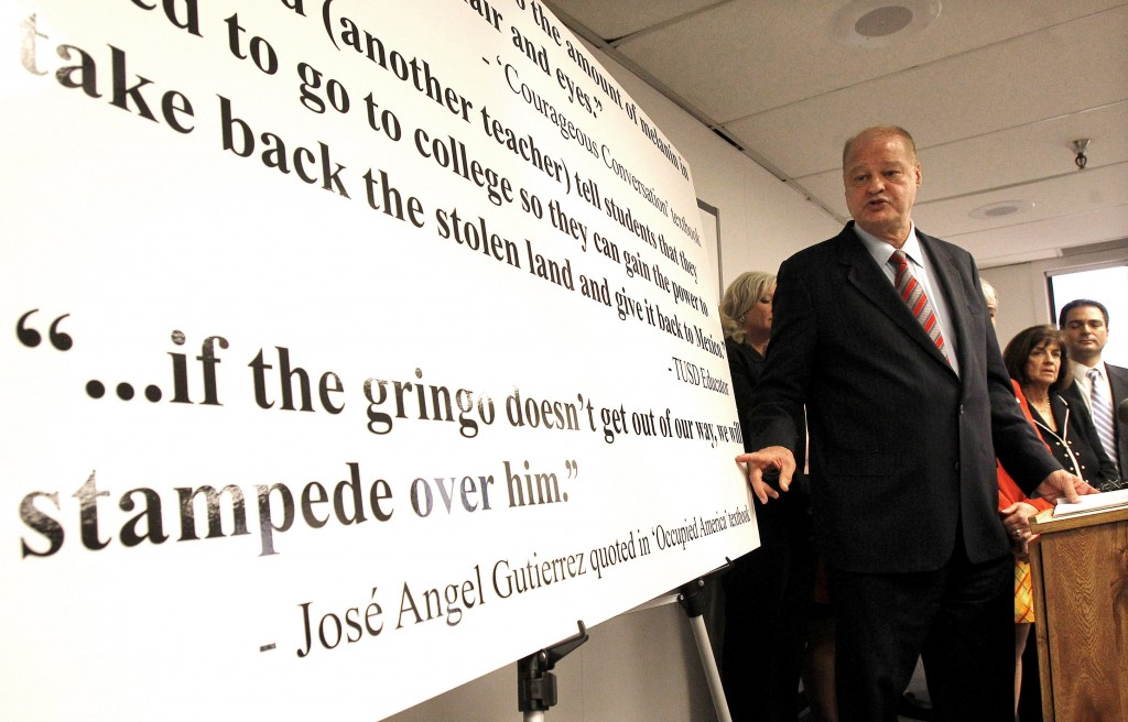 FILE - In this Jan. 3, 2011 file photo, outgoing Arizona schools chief Tom Horne asserts that a major school district in Tucson is violating a new sta...