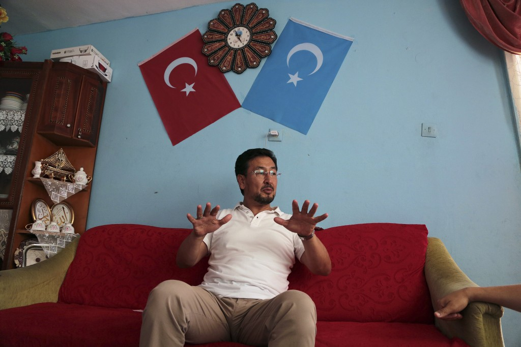 In this Aug. 7, 2017 photo, Seyit Tumturk, a Uighur activist speaks near in a resettlement community in Kayseri in central Turkey. As Uighurs flee a C...