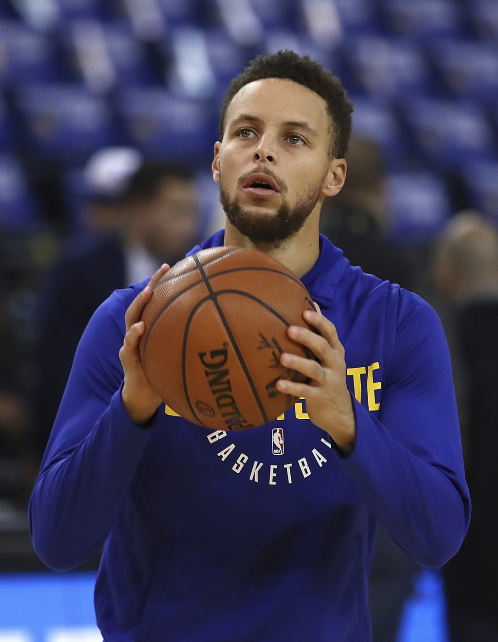 Golden State Warriors' Stephen Curry warms up prior to an NBA basketball game against the Charlotte Hornets on Friday, Dec. 29, 2017, in Oakland, Cali...