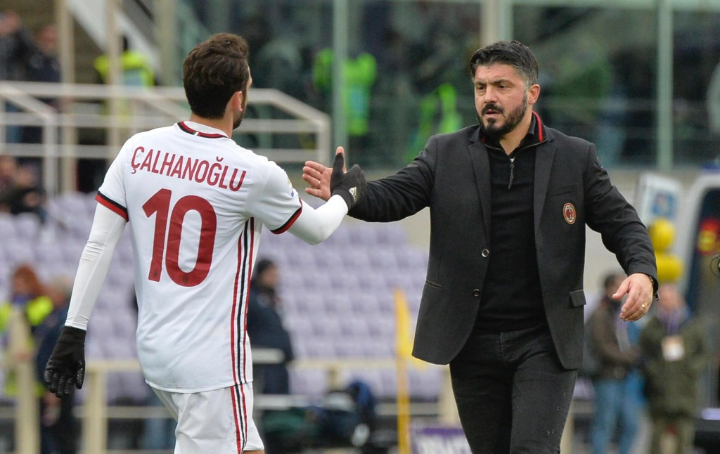 Milan's Hakan Calhanoglu celebrates with coach Rino Gattuso after scoring the final equalizer during the Italian Serie A soccer match between Fiorenti...