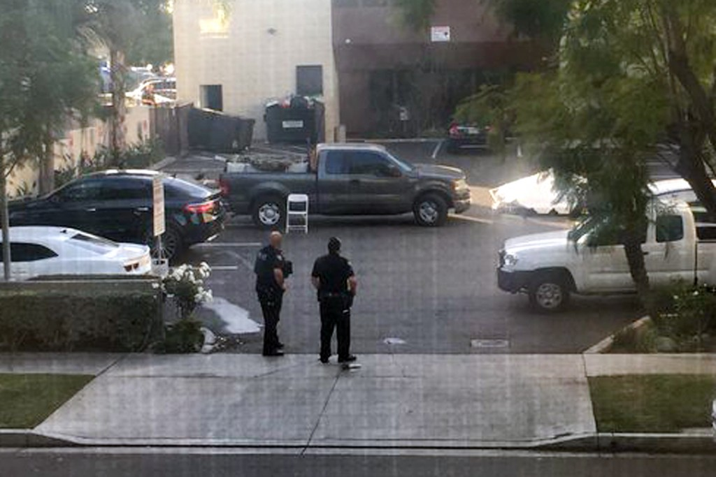 This photo provided by Basileus Zeno shows police at the scene of an active shooting in Long Beach, Calif. Friday, Dec. 29, 2017. Police say there are...