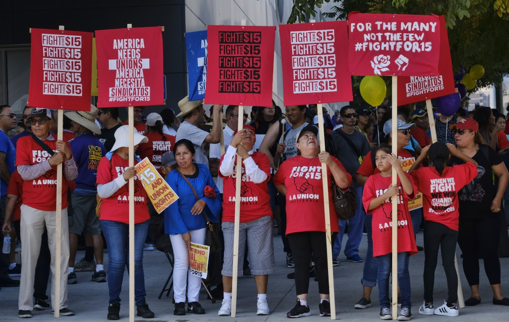 In this Sept. 4, 2017 photo, Union workers and minimum wage activists gather for a Labor Day rally in downtown Los Angeles. California state lawmakers...