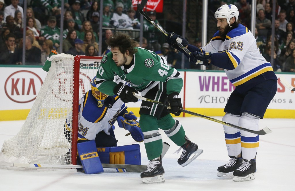 Dallas Stars left wing Remi Elie (40) is shoved by St. Louis Blues right wing Chris Thorburn (22) as goaltender Jake Allen (34) defends during the fir...