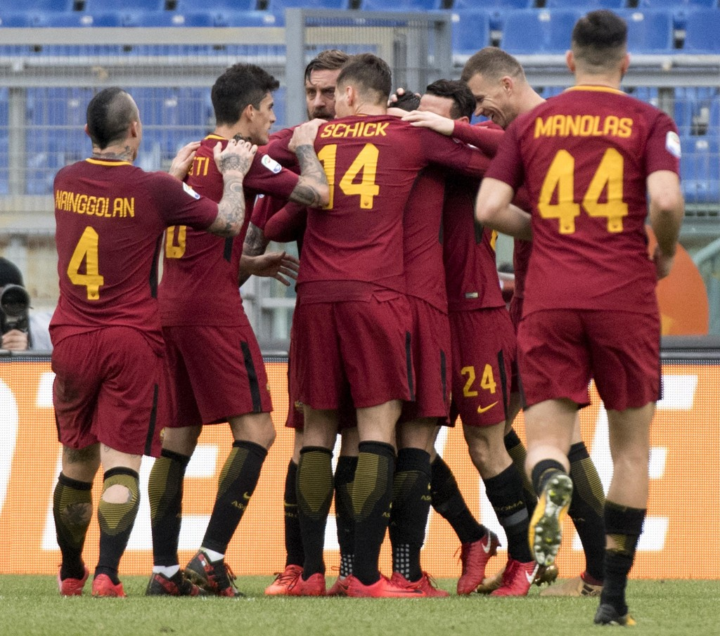 Roma's Lorenzo Pellegrini, center, is celebrated by his teammates after scoring during the Serie A soccer match between Roma and Sassuolo at the Olymp...