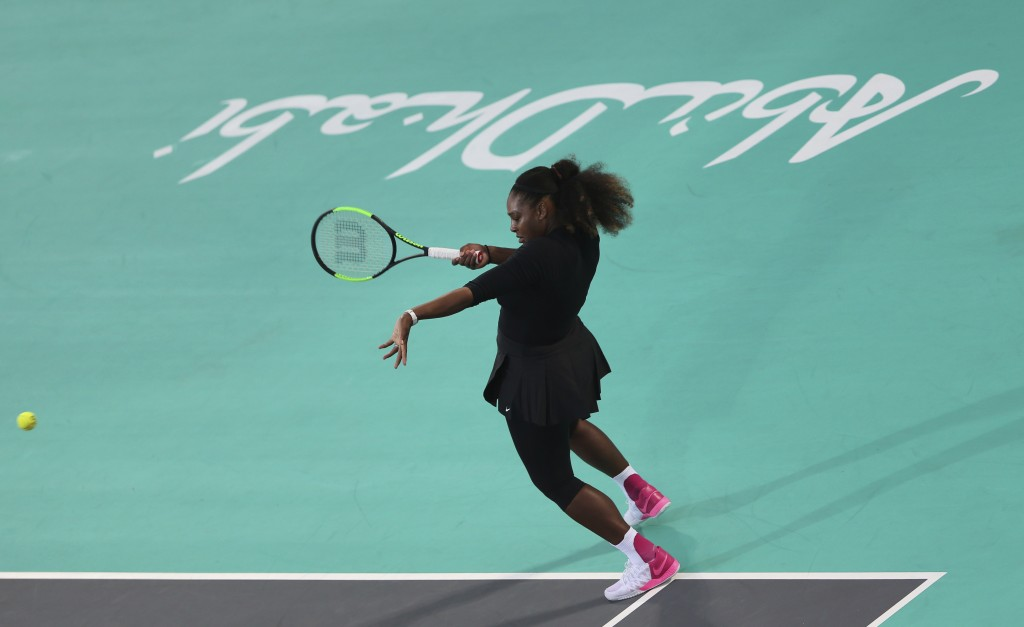 Serena Williams from the U.S. returns the ball to Jelena Ostapenko of Latvia during the final day of the Mubadala World Tennis Championship in Abu Dha...